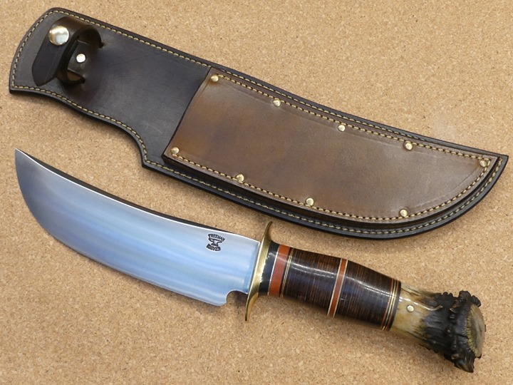 History of Treeman Knives®  Treeman Knives ®, the original J. Behring Handmade began in 1998 as a one-man operation dealing in antique knives such as Marbles, Ruanas, Randalls, and many others across the country and throughout  the world. I have bought and sold thousands of knives over the years, but I was always fascinated with William Scagel knives.  Then one day I decided to try and make my own replica in the traditional Scagel style with some influence from MSA Co, Ruana, and Randall. I soaked up as much information as I could and then bought my first upright grinder and a few other must have knife-making tools and got to work. Having a background in the forging die trades from years past, I comfortably knew my way around grinding and finishing metal. I finished my first small batch of knives and took them to a local show in Michigan.  Paul Baush from A G Russel knives  bought all my knives. In that moment, that was it! I bought several belt grinders, buffers, ovens, a gas forge, anvils, and the list went on. I then added on to the shop and built an office where my wife, Deanna, and I still work today. I made more and more knives and they continued to sell. I worked hard to create my own quality style and design. It was seven days a week with 10 to 12-hour days for nearly 7 years of nonstop dealing, making, and selling all sorts of knives and build the Treeman name . I attended as many as 25 shows per year across the country in order to promote my business, buy and sell knives, as well as meet and greet people from all over. The rest is history. I have been a fulltime knife maker ever since and have made several thousand knives to date.    In 2009, I got a call from  Navy Seal, Eric, and his buddy Tony. They asked me to make them a few heavy-duty combat tactical fighter knives. We worked out a design and it was then that the Ultra Phalanx was born. I then produced more for other Navy Seals they new  and slowly the word got out. Naturally, the tactical line of Tr